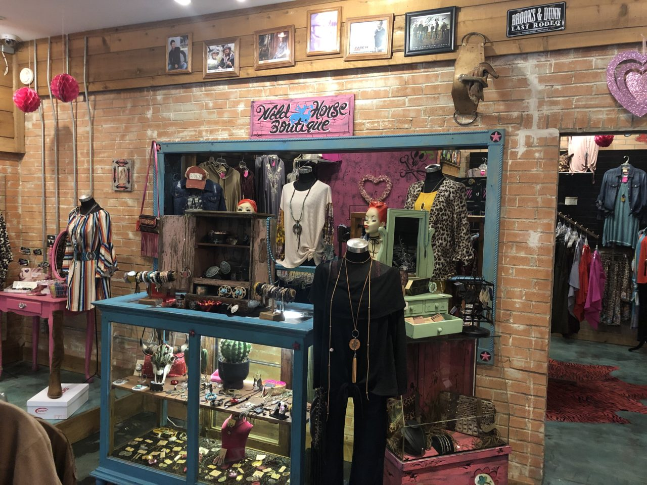 Wild Horse Boutique wall sign, sales floor  with dresses jewelry and clothing