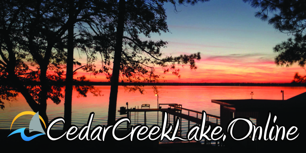 sunset on cedar creek lake with cedar creek lake logo on top