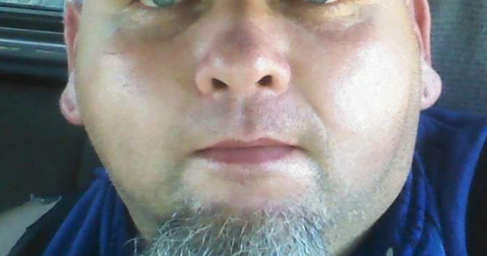 close up of man's face with goatee